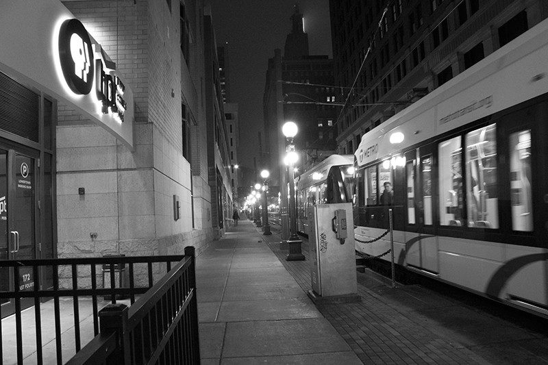 Photo of light rail train passing the TPT Twin Cities PBS office building in downtown St. Paul