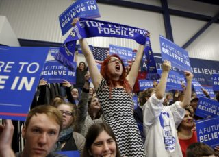 Supporters of Sen. Bernie Sanders cheer during his rally at Great Bay Community College in Portsmouth, New Hampshire, Sunday