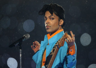 Prince performs during the halftime show of the NFL's Super Bowl XLI football game between the Chicago Bears and the Indianapolis Colts in Miami, Florida February 4, 2007.