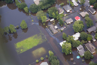 Contaminated floodwaters impact a neighborhood as seen in an aerial view in Sorrento, Louisiana, U.S. August 17, 2016.