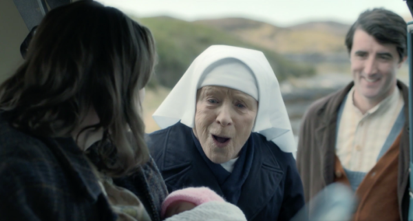 nun looking at woman holding baby in car
