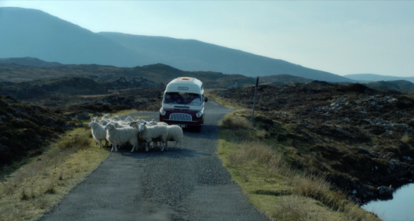 scottish mountains with van and sheep