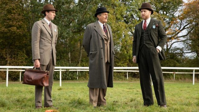 three men in old suits